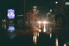 trample (maximumdembo) Tags: nottingham color colour reflection bus film rain night 35mm fuji low tram olympus xa2 olympusxa2 citycentre 400iso fujisuperiaxtra400 ratseyeview localtransport lowdownshot