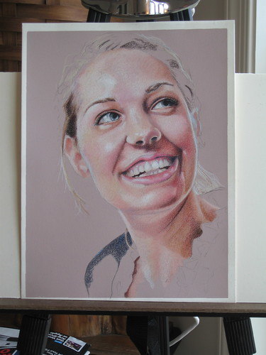 Photo of in progress colored pencil portrait entitled Rachel.