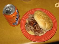 Pulled pork sandwich and orange soda