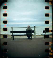 Waiting For The Man (AndyWilson) Tags: tlr beach 35mm bench seaside sitting promenade hastings 400asa bbf blackbirdfly chst08 chpe08 chpb09 ajwch