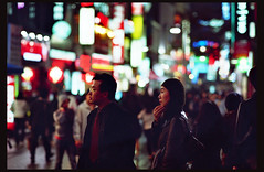 (*NanKuruNaiSa*) Tags: street nightphotography people urban film night 35mm lowlight nikon asia bokeh candid korea seoul f2 nikkor southkorea manualfocus kodakgold  nikonfe2  fe2 kodakgold200 availiblelight nikkor85mmf14ais crapscans autofocusisoverrated anocturnalseoul
