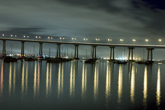 The Moorings from Tideland Park (TallCJ) Tags: ca bridge night clouds canon reflections lights 100v10f baybridge sailboats coronado soe extendedexposure courtneyjohnson sandiegobay bej worldbest tidelandspark superaplus aplusphoto goldstaraward rebelxsi absolutelystunningscapes