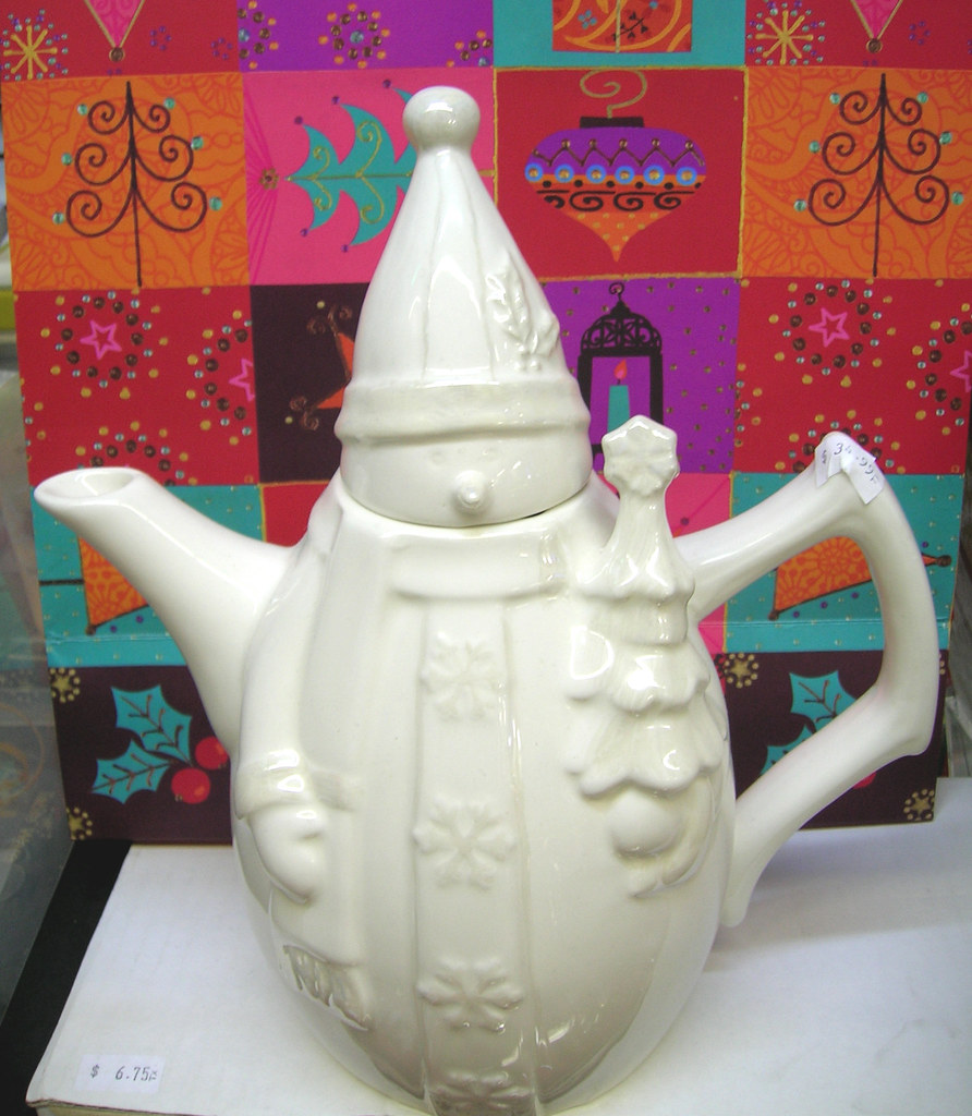 With Silver plated accent porcelain tea pot-$15