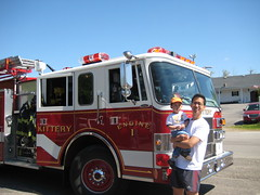 Owen with Daddy in front of Kittery Fire Truck