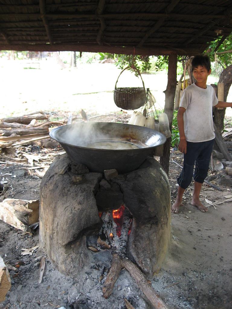 Boy cooking palm sugar.