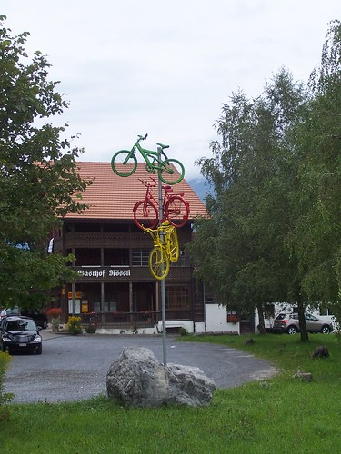 Some bikes on a pole
