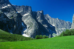 Trollveggen (H o g n e) Tags: blue summer mountain mountains color colour green norway rock landscape grey landscapes gray explore coolscan clearsky rockformations romsdalen fe2 mountainpeaks trollveggen bildekritikk