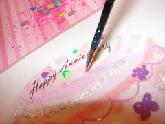 Use paint brush to detail with glitter glue