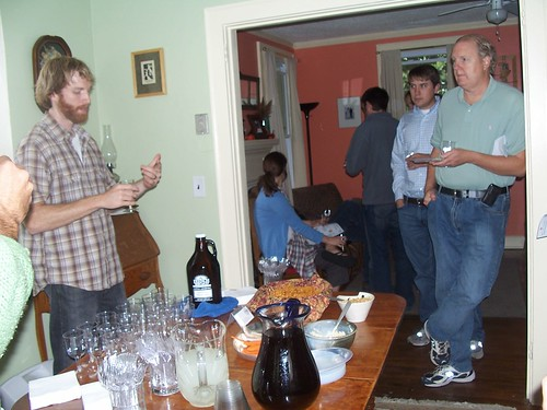 everyone listens intently to the beer master