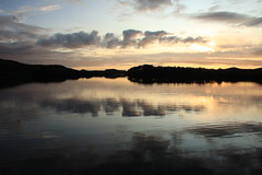 Sunset on Beannach. (Gordie Broon.) Tags: sunset summer reflection nature water landscape geotagged photography scotland fishing scenery alba scenic escocia loch sutherland schottland ecosse lochinver cloudreflections assynt scottishhighlands westernhighlands canoneos40d lochbeannach gordiebroon
