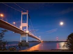 That bridge again. (Roger.C) Tags: longexposure bridge blue moon reflection wales night canon river dark colours searchthebest motorway severn coastal chepstow m4 wfc 30d beachley abigfave infinestyle