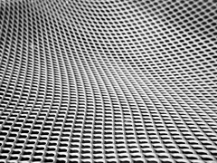 HBW! (metal chair) (tanakawho) Tags: bw white abstract macro net geometric metal chair pattern dof bokeh curvy line curve fabulous instantfave hbw tanakawho 1on1abstractionspatternsphotooftheweek 1on1abstractionspatternsphotooftheweeknovember2008