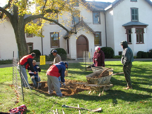 Excavating the hole for the new statues base in front of President Lincolns Cottage.