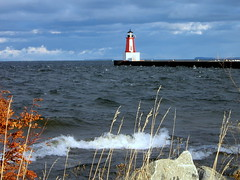 Menominee Michigan  Lighthouse on the Bay (**Ms Judi**) Tags: blue red sky lighthouse cold water beautiful up leaves rock clouds wonderful bay pier nice weeds rocks pretty waves view shot michigan wave bluesky greenbay lovely scape thebay menominee choppy michiganlighthouses roughwater beautifulshot choppywater msjudi mywinners abigfave anawesomeshot goldstaraward menomineelighthouse
