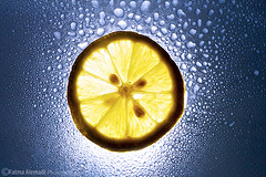 More Lemon ; ) (Fatma Alemadi) Tags: light macro water yellow drops lemon sunpak strobist rebelxti