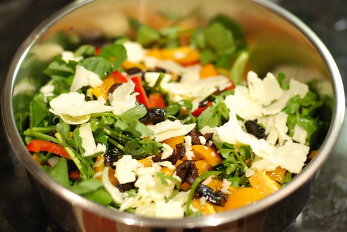 Watercress with red pepper, black olives, cheddar, and tomatoes