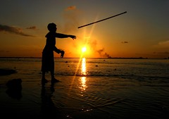 frozen in time (mohlat) Tags: ocean life boy sunset sea vacation sky sun holiday clouds reflections dark island photography photo yahoo kid perfect asia flickr waves photographer shots silhouettes photographers wave lagoon images um stick ripples sunrays maldives beautifulview frozenintime blueribbonwinner visitmaldives villingili maldivians saarc abigfave anawesomeshot canonpowershota710is superbmasterpiece diamondclassphotographer uniquemaldives flickrelite mohlat simplymaldives theperfectphotographer mohamedlatheef