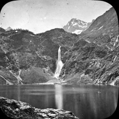 Lac d'O, Luchon (bibliothequedetoulouse) Tags: mountain lake snow mountains reflection water stone montagne landscape waterfall lac peak surface falls neige flowing cascade paysages bibliothquedetoulouse commons:event=commonground2009