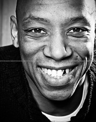 Ian Wright (Photosmudger) Tags: portrait england blackandwhite gold football soccer teeth headshot player grin players arsenal lightroom gladiators ianwright canoneos5d strobist