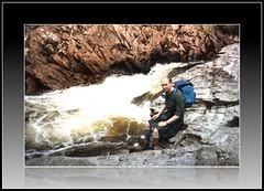 Kiltie by a babbling brook (FotoFling Scotland) Tags: summer man male men fashion river walking freedom scotland rocks stream kilt boots hiking manly scottish adventure scot richard type activity rucksack tartan commando westhighlandway kilted sporran scotsman treking kiltie freeballing kiltlad kiltedscotsman kiltedman richardfindlay tartankilt truescot andaralogringo andarstrike