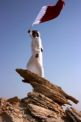 (~~[(QTR)]~Mubarak~) Tags: sun me rock proud sand ipod desert maroon flag south country nine explore gloves be arrows modelling qatar     qatari  hawaalrayyanfav inspiredbyhector thwob