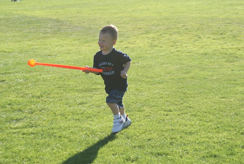 One of my favorite shots of Aidan...holding Bela's ball thrower