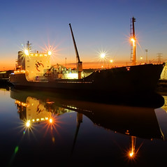 Onehunga Port Shot 2 (Mark Emirali) Tags: ocean longexposure light sunset newzealand reflection water glass night port canon square twilight ship nz flare aotearoa onehunga 30d copyrighted canon30d pleasedonotusewithoutmypermission maloe4 maloephoto maloephotography markemirali markemiraliphotography