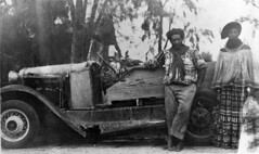 Frank and Annie Charlie standing beside their car (State Library and Archives of Florida) Tags: florida seminoles everglades frankcharlie statelibraryandarchivesofflorida anniecharlie