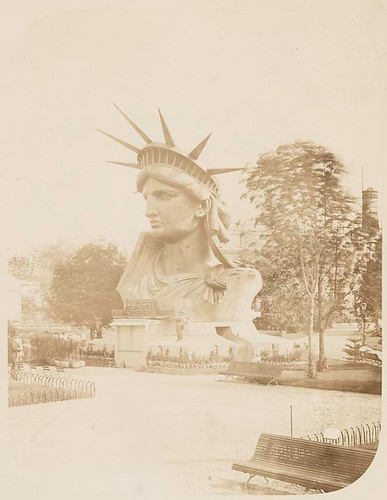 [Head of the Statue of Liberty on display in a park in Paris...