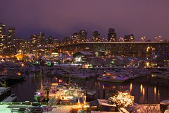 Granville Island In the Snow at Dusk (Adri L) Tags: ocean christmas longexposure bridge winter sea holiday snow cold water landscape boats lights downtown purple dusk granville yule granvilleisland snowfall