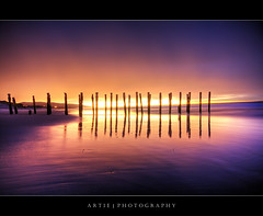 Sunrise @ St Clair Beach, Dunedin, New Zealand :: HDR (:: Artie | Photography ::) Tags: new christchurch reflection beach nature photoshop sunrise canon landscape landscapes sand bravo shine cs2 stclair jetty wideangle zealand shore handheld southisland dunedin poles 1020mm hdr artie 3xp sigmalens photomatix tonemapping tonemap stclairbeach 400d rebelxti