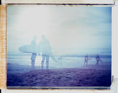 end of the day (czuczy) Tags: sunset dog beach sand waves doubleexposure surfers cooler surfboards expired twelve loredo polaroid450 iduvfilm threelo2 a1surf