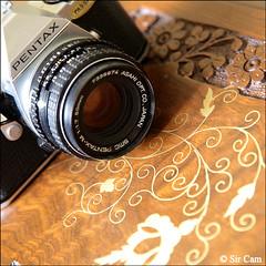 My first camera (Sir Cam) Tags: camera decorations cambridge pakistan england india film canon table eos wooden pentax heathrow delhi diary 5d islamic mesuper myfirstcamera sircam