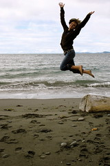 Emily (kboy_photo) Tags: ocean color water jumping log sand whidbeyisland suspendedinair