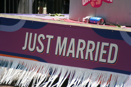"A ""just married"" sign on the back of a float."