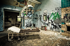 Next patient please (Beelitz) (Ole Begemann) Tags: postprocessed abandoned hospital germany geotagged deutschland graffiti bed bett ruins decay fliesen neglected surgery tiles vandalism weathered op sanatorium 2008 derelict brandenburg hdr krankenhaus rundown verlassen ruinen eastgermany verwittert vandalismus photomatix soviets militaryhospital chirurgie beelitzheilsttten operationssaal opsaal tonemapped beelitz 5xp potsdammittelmark gefliest sowjets vernachlssigt heilsttten beelitzheilstaetten militrkrankenhaus original:filename=2008072020d032464032468hdr16