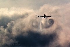 Wake turbulence - Swirl Vortex (Greg Bajor) Tags: uk london weather clouds plane airplane flying airport wake heathrow aircraft aviation united flight kingdom aeroplane atlantic landing virgin airbus approach a340 chasing descending tailwind turbulance whirls waketurbulence wingtipvortices gregbajor