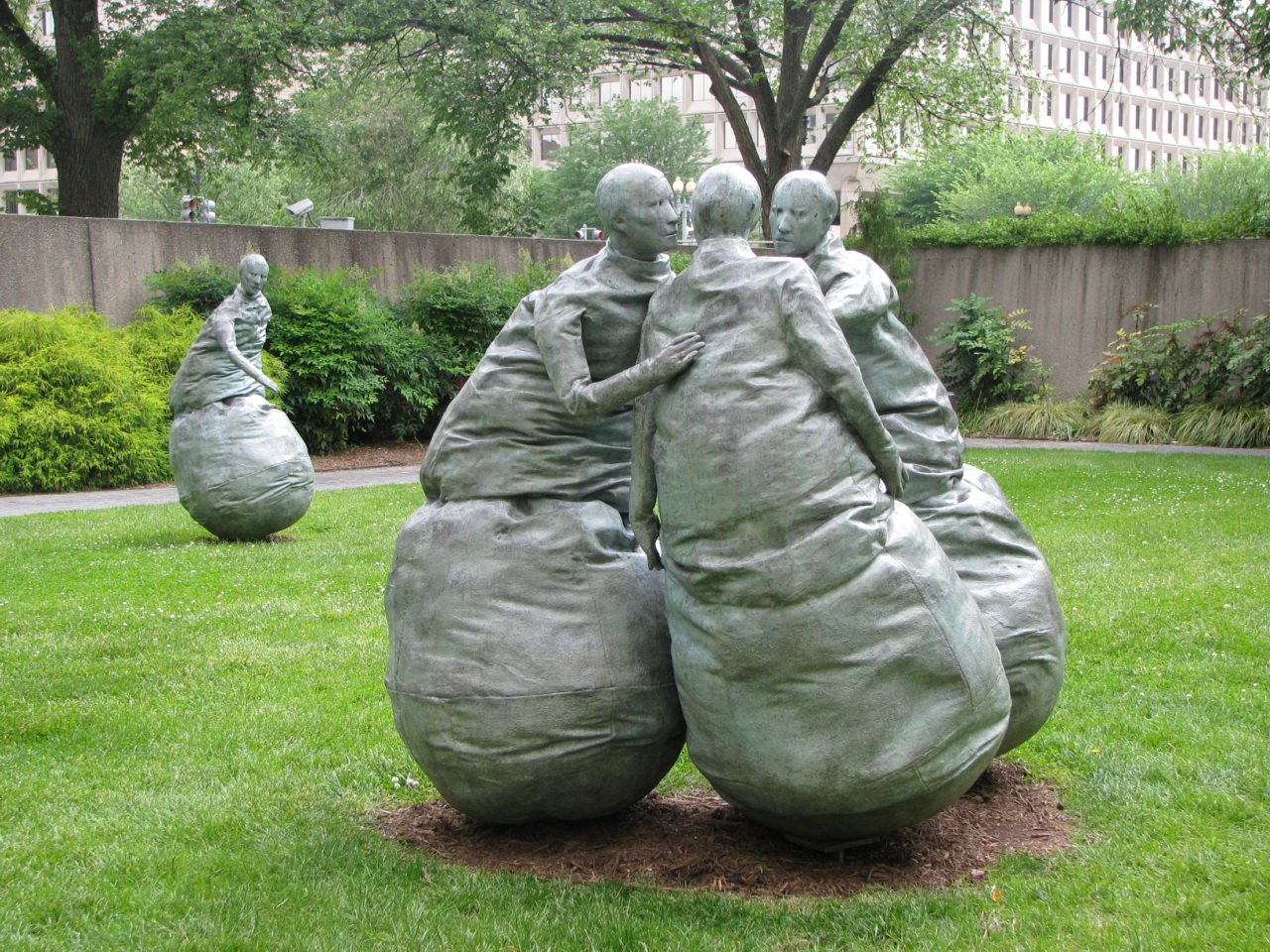 a picture of statues having a conversation