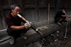 Pipesmoker (Emyr R. E. Pugh) Tags: china road portrait people water construction break digging pipe chinese smoking yan stick worker smoker guizhou tobacco incense shui documentaryphotography chinesemen lifeinchina shuiyan dailylifeinchina ordinarychinesepeople streetlifeinchina