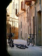 Abandoned bikes (pompey shoes) Tags: street shadow bike bicycle buildings spain alley espana mallorca palma majorca gamewinner photofaceoffwinner photofaceoffplatinum thechallengegame challengegamewinner pfogold pfoplatinum cotcbestof2008 nov08pfobrackets herowinner ultraherowinner thepinnaclehof tphofweek8 gamex3winner gamex2sweepwinner ispywinner friendlychallengesdiamondaward