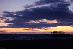 ! , (  ) Tags: uk blue sunset england sky orange cloud sun building beach yellow set night clouds dark pier brighton romance shore fading tones alhamar khalid bosultan