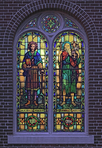 Saint Mary Roman Catholic Church, in Carlyle, Illinois, USA - stained glass window of Saint Isidore Farmer and Saint Christopher