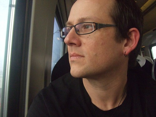 Self-portrait on a train