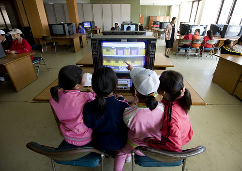 Picture of children infront of computer