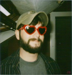 LOVE (ChristinaBrown) Tags: love window smile hat beard polaroid james cool cam 600 flannel heartshapedglasses