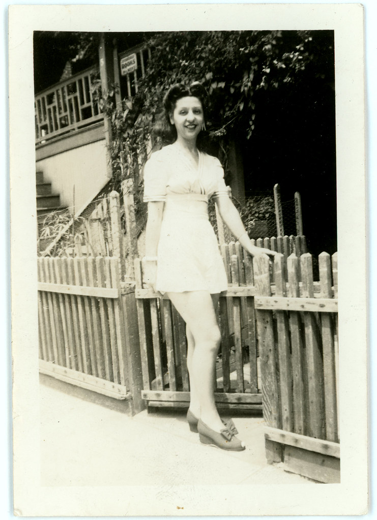 Girl at steps in white sunsuit