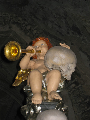 angel baby holding a skull by alumroot