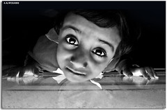 Look ..  (A.Alwosaibie) Tags: boy white black window look photo eyes nikon shot 1855mm d60       blackwhitephotos  abigfave impressedbeauty  damniwishidtakenthat