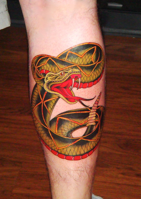 My rattlesnake calf piece. Flash is classic Sailor Jerry, tattoo done by the