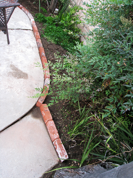 Brick lined garden planter 3